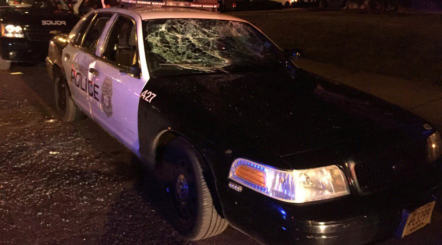A police car with broken windows is seen in a photograph released by the Milwaukee Police Department after disturbances following the police shooting of a man in Milwaukee, Wisconsin, U.S. August 13, 2016. © Milwaukee Police