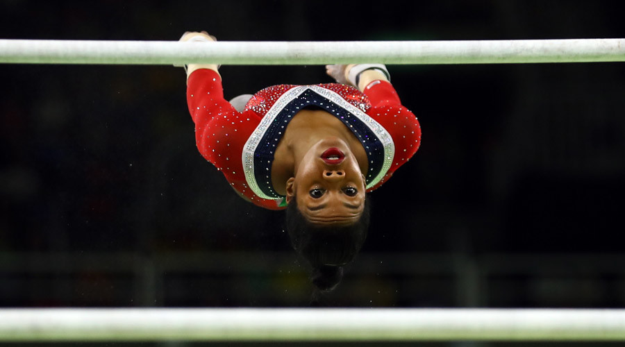 Gabby Douglas competing in uneven bars © Mike Blake