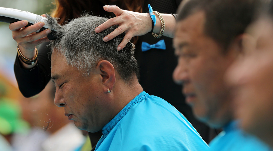 Seongju residents get their heads shaved during a protest against the government's decision to place a U.S. Terminal High Altitude Area Defence (THAAD) anti-missile defence unit in their town, in Seongju, South Korea, August 15, 2016. © Kim Jun-beom