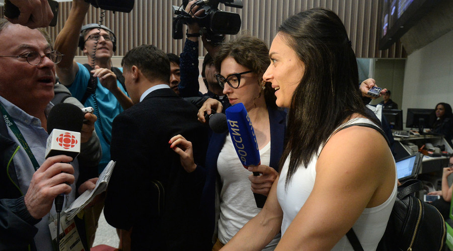 Yelena Isinbayeva answers questions from journalists at the airport in Rio de Janeiro. © Alexey Kudenko