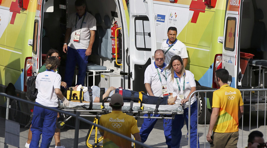 A woman is transported to an ambulance after being hit by an overhead television camera that fell and injured two people near the Olympic Park venues for basketball and judo at the Rio 2016 Olympics in Rio de Janeiro, August 15, 2016. © Toru Hanai