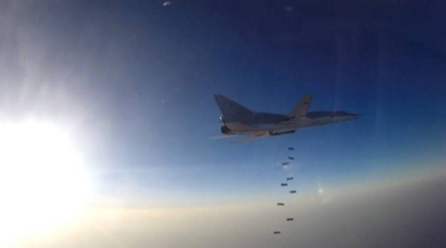 A still image, taken from video footage and released by Russia's Defence Ministry on August 16, 2016, shows a Russian Tupolev Tu-22M3 long-range bomber based in Iran dropping off bombs at an unknown location in Syria. © Ministry of Defence of the Russian Federation