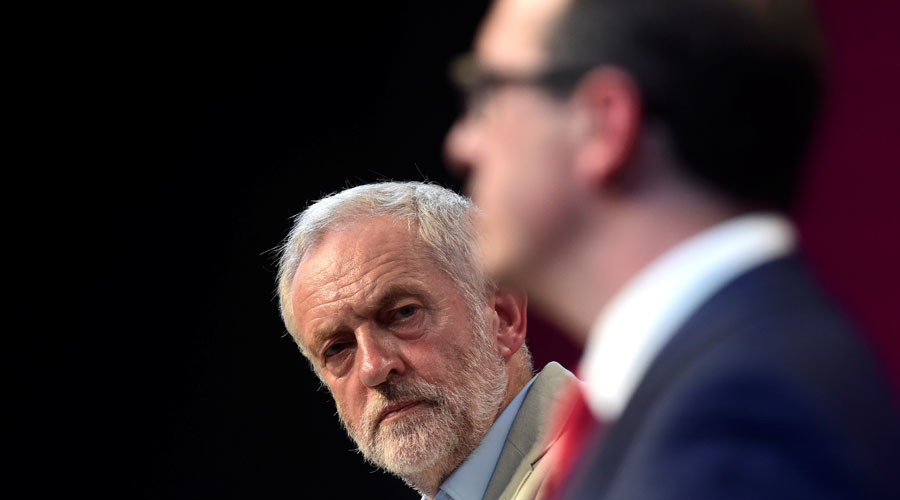 Labour Party leader Jeremy Corbyn listens during a debate against challenger Owen Smith © Rebecca Naden