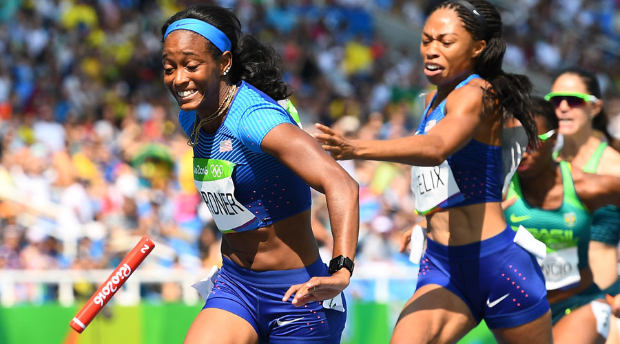 USA's Allyson Felix attempts to hand the baton to USA's English Gardner in the Women's 4 x 100m Relay Round 1 during the athletics event at the Rio 2016 Olympic Games at the Olympic Stadium in Rio de Janeiro on August 18, 2016.© Franck Fife