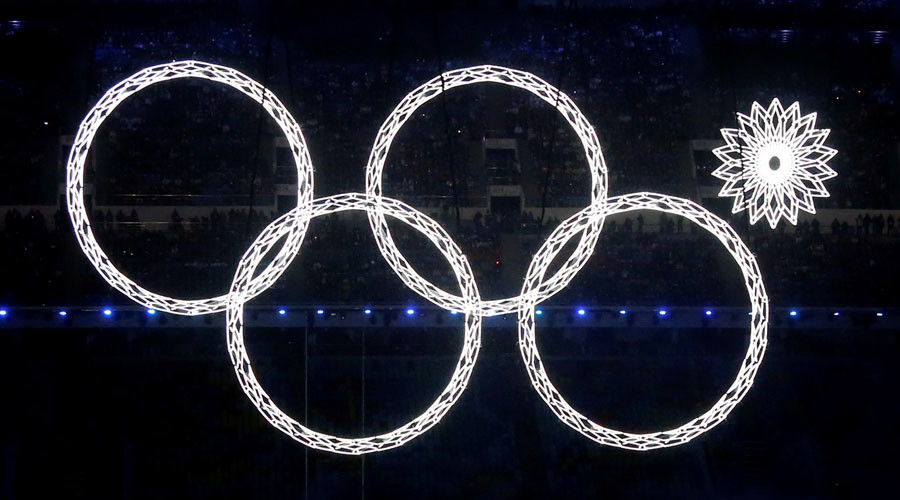 Four of five Olympic Rings are seen lit up during the opening ceremony of the 2014 Sochi Winter Olympics, February 7, 2014. © Lucy Nicholson