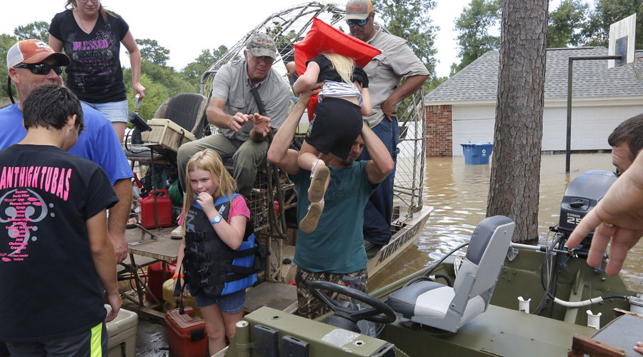 Trump visits Louisiana amid worst flooding since ...