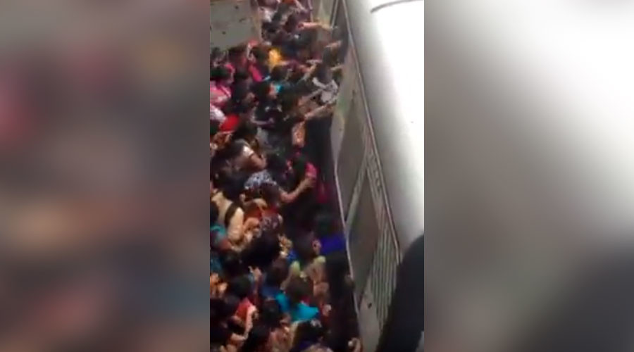 Terrifying crush at Mumbai station sees women fall under train (VIDEO)