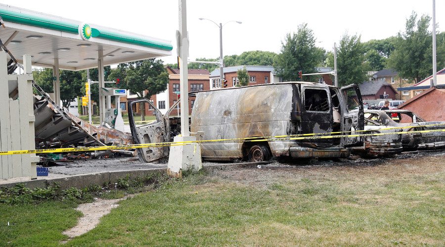 A burned down gas station is seen after disturbances following the police shooting of a man in Milwaukee, Wisconsin, U.S. August 15, 2016. © Aaron P. Bernstein
