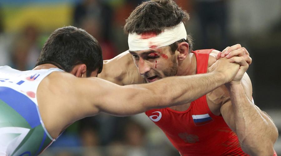 Aniuar Geduev (RUS) of Russia and Hassan Yazdanicharati (IRI) of Iran compete. © Adrees Latif
