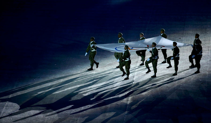 The Olympic flag is carried during the closing ceremony in Rio. © Vasily Fedosenko