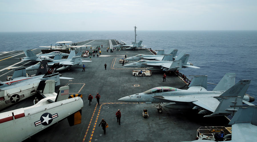 F/A-18 Hornet fighter jets and E-2D Hawkeye plane are seen on the U.S. aircraft carrier John C. Stennis © Nobuhiro Kubo