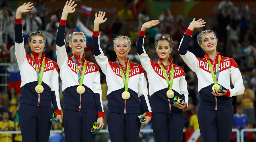 Team Russia (RUS) pose with their gold medals on the podium. © Mike Blake