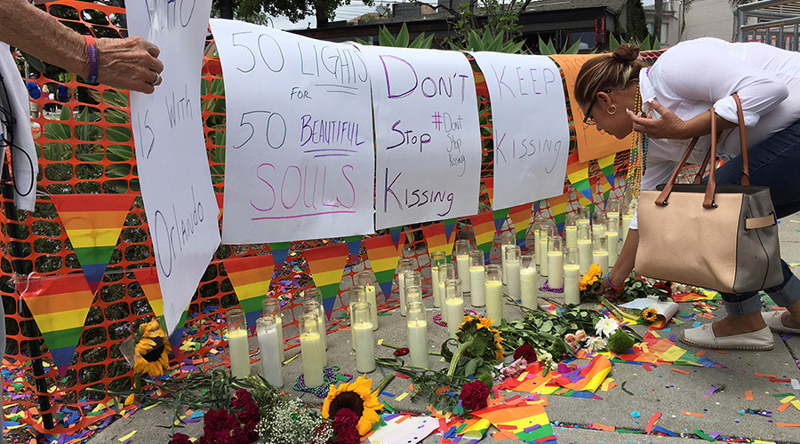 FILE PHOTO: People tend to a memorial at the Christopher Street West presentation of the Los Angeles LGBT Pride Parade in West Hollywood, California, U.S. June 12, 2016 in honor of the victims of the deadly attacks at a gay night club in Orlando, Florida earlier in the morning © Lisa Richwine