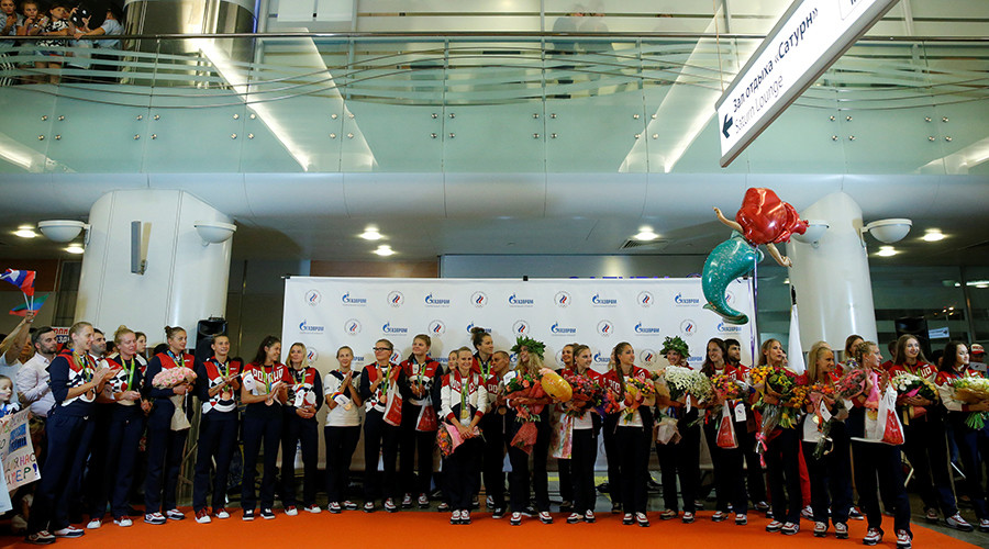 Members of the Russian Olympic team attend a welcoming ceremony as they return home from the 2016 Rio Olympics, at Sheremetyevo International Airport outside Moscow, Russia, August 23, 2016 © Maxim Zmeyev