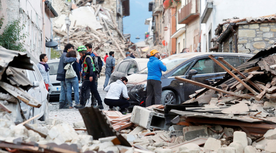 People stand along a road following a quake in Amatrice, central Italy, August 24, 2016. © Remo Casilli