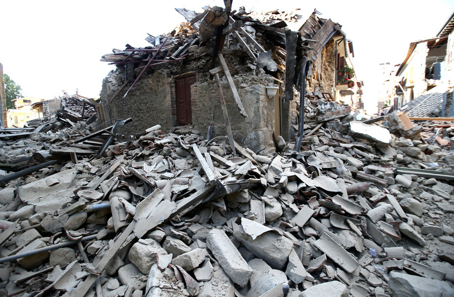 A collapsed house is seen following an earthquake in Amatrice, central Italy, August 24, 2016. © Stefano Rellandini