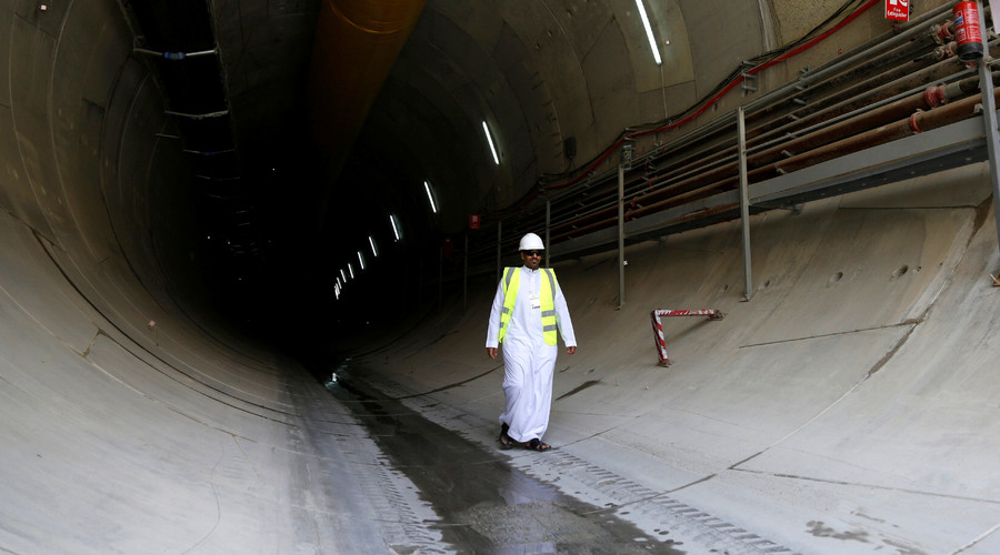 A man walks inside a tunnel of the under-construction Riyadh Metro, Saudi Arabia. © Faisal Al Nasser