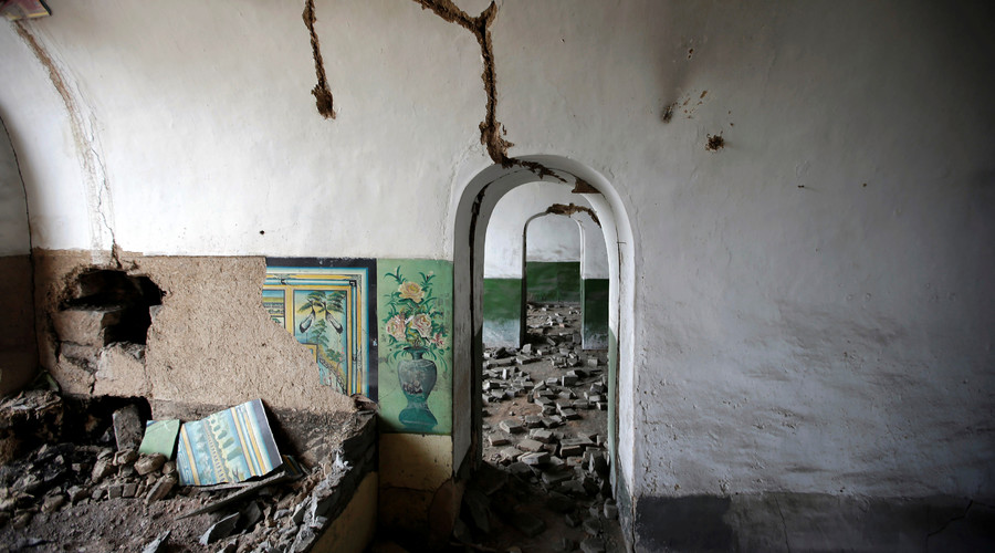 Damaged walls are seen inside an abandoned cave house in an area where land is sinking next to a coal mine in the deserted Liuguanzhuang village of Datong, China's Shanxi province, August 1, 2016. © Jason Lee