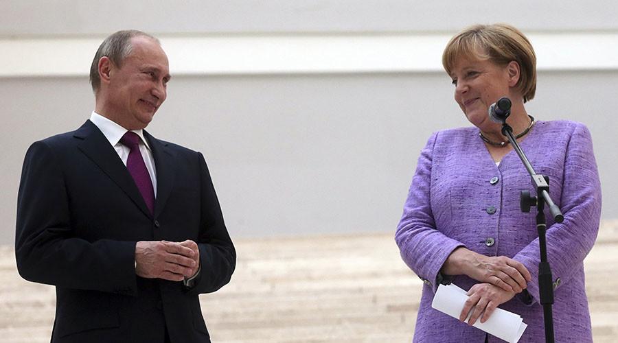 Russian President Vladimir Putin President and German Chancellor Angela Merkel. ©Anatoly Maltsev