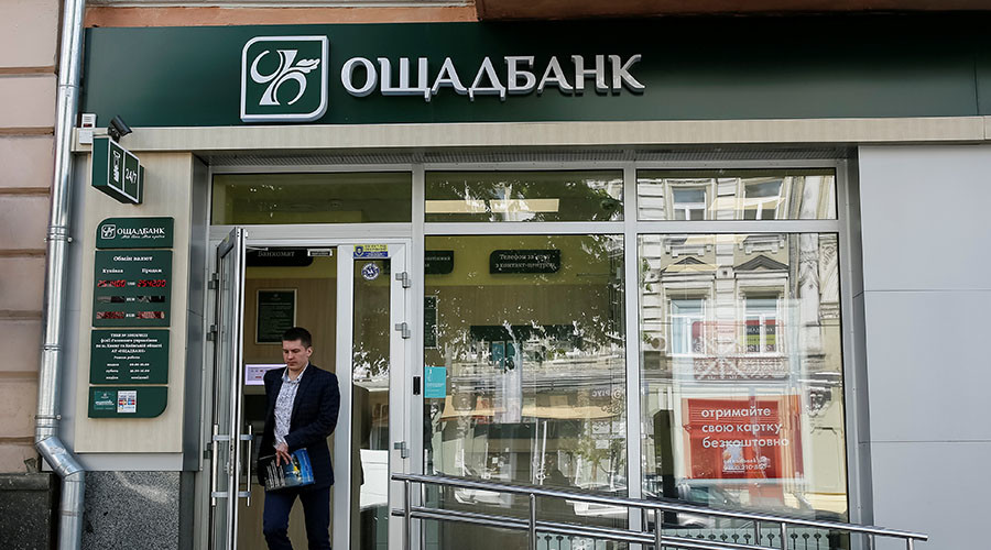 A man leaves a branch of Oschadbank in Kiev, Ukraine. © Gleb Garanich