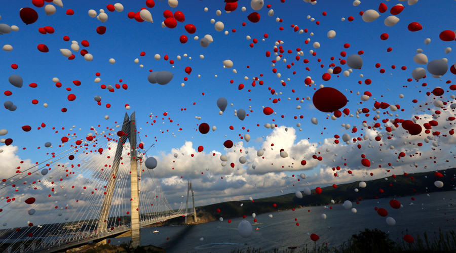 Red and white balloons are released during the opening ceremony of newly built Yavuz Sultan Selim bridge, the third bridge over the Bosphorus linking the city's European and Asian sides in Istanbul, Turkey. © Murad Sezer