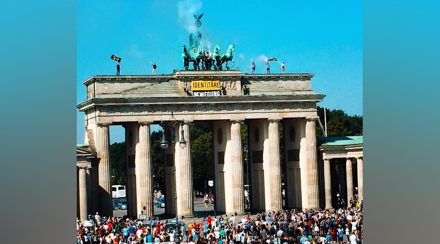 'Fortress Europe': Anti-refugee activists climb Brandenburg Gate to oppose 'rampant' immigration