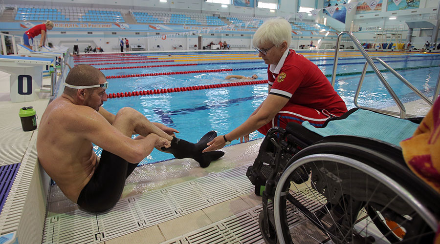 Iskander Mustfayev and his coach Irina Mashchenko during a training session of the Russian Paralympic team in Ruza. © Vitaliy Belousov