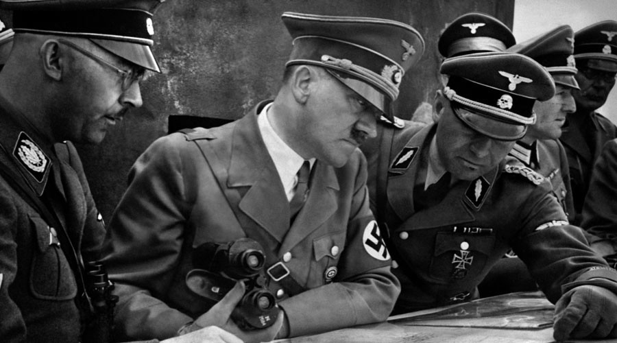 A picture dated 1939 shows German Nazi Chancellor and dictator Adolf Hitler (C) consulting a geographical survey map with his general staff including Heinrich Himmler (L) and Martin Bormann (R) © France Presse Voir