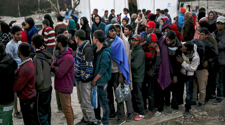 More than 300,000 refugees in Germany work illegally, pay kickbacks to asylum center staff - reports