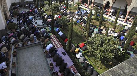 Muslims pray at a mosque in Paris. ©Zohra Bensemra