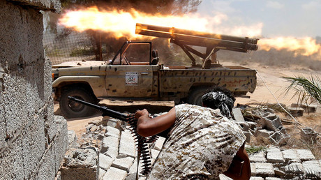 Libyan forces allied with the U.N.-backed government fire weapons during a battle with IS fighters in Sirte, Libya, July 21, 2016. © Goran Tomasevic