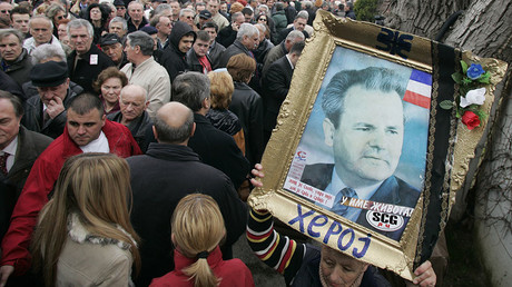Supporters of Slobodan Milosevic wait in line to pay their respect at the former president's grave in Pozarevac March 10, 2007. ©Marko Djurica