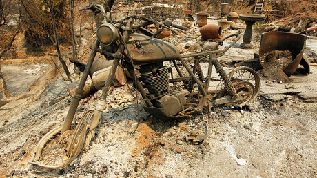 A motorcycle at the site of a destroyed home after the Soberanes Fire tore through the Palo Colorado area, north of Big Sur, California, US, July 31, 2016 © Michael Fiala