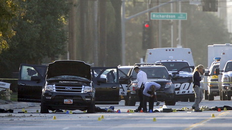 Crime Scene investigators examine the scene of the investigation around an SUV where two suspects were shot by police following a mass shooting in attack in San Bernardino, California December 4, 2015. © Alex Gallardo