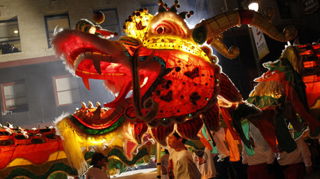 Participants perform a dragon dance during the annual Chinese New Year Parade © Stephen Lam
