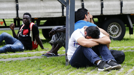 Migrants rest on the ground, Duesseldorf, Germany. © Wolfgang Rattay