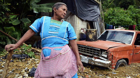 Local resident Enriqueta Diaz works amid the damage caused by a landslide ensuing the passage of Tropical Storm Earl in the community of Xaltepec, Puebla state, eastern Mexico on August 8, 2016. © Alfredo Estrella