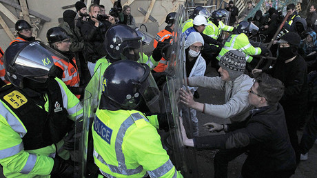 Demonstrators clash with riot police during evictions at the Dale Farm Traveller site near Billericay, southern England October 19, 2011. © Luke MacGregor