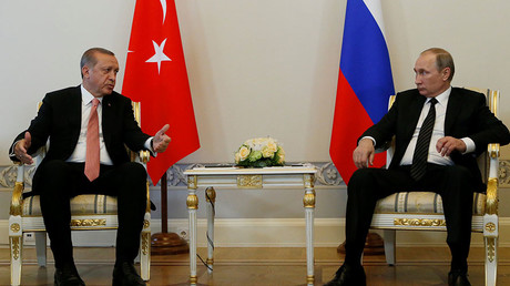 Turkish President Tayyip Erdogan speaks to Russian President Vladimir Putin (R) during their meeting in St. Petersburg, Russia, August 9, 2016. © Sergei Karpukhin