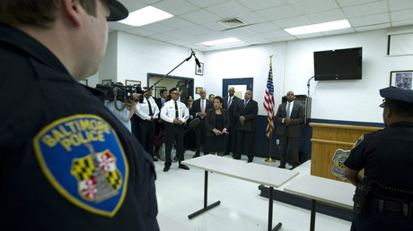 U.S. Attorney General Loretta Lynch, accompanied by Baltimore police Commissioner Anthony Batts, speaks to police officers during a visit to the Central District of Baltimore Police Department in Baltimore, Maryland, United States, May 5, 2015. © Jose Luis Magana