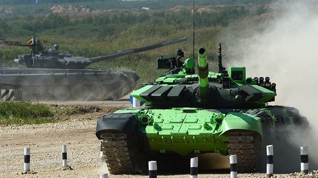 Crew of the Iranian Army's T-72B3 tank during a competition in tank biathlon at Alabino proving ground. © Evgeny Biyatov