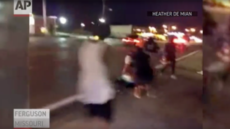 Gunshots heard after car hits Ferguson protester on anniversary of Michael Brown's death