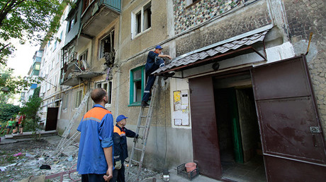 08.01.2016. Employees of the gas service restore gas supplies damaged by shelling of the city by Ukrainian forces in a five-story building in Yasinovataya. © Sergey Averin