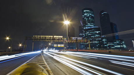 Cars pass by the Moscow  business district
