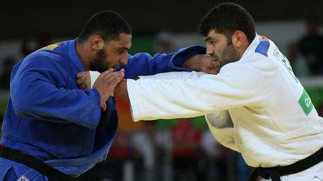 Or Sasson (ISR) of Israel and Islam El Shehaby (EGY) of Egypt compete. © Toru Hanai