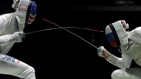 Miles Chamley-Watson (US) and Artur Akhmatkhuzin (Russia) after a semi-final of the men's foil team competition at the XXXI Summer Olympics. © Grigoriy Sisoev