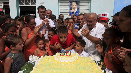 Ten-year-old Marlon Mendez, who claims to be an admirer of Cuba's former president Fidel Castro, blows out the candles on birthday cake to celebrate the 90th birthday of Cuban former president Fidel Castro, in San Antonio de los Banos, Cuba, August 10, 2016. © Enrique De La Osa