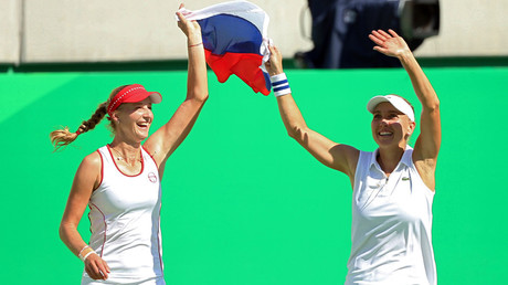 Elena Vesnina of Russia and Ekaterina Makarova of Russia celebrate after winning their match against Martina Hingis of Switzerland and Timea Bacsinszky of Switzerland. © Kevin Lamarque