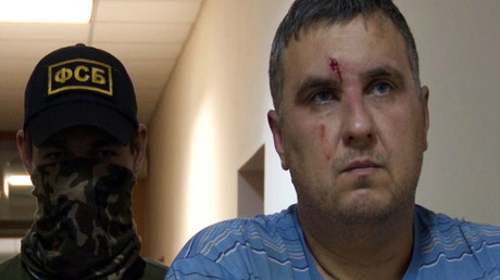 Right: a suspected Ukrainian saboteur detained by the Russian Federal Security Service in Crimea. (A still from a video, courtesy of the FSB Public Relations Center). © Public relations center of Federal Security Service