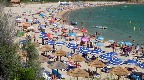Holiday makers enjoy the high temperatures at the beach, near Cargese in the French island of Corsica. © Charles Platiau